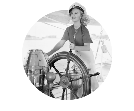 woman steering a ship